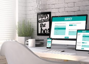 Business concept: Devices generated with survey responsive web on the screen on stilish workplace. All graphics are made up.