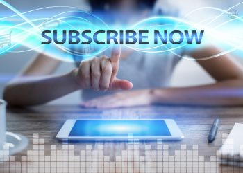 Woman using tablet pc, pressing on virtual screen and selecting subscribe now.